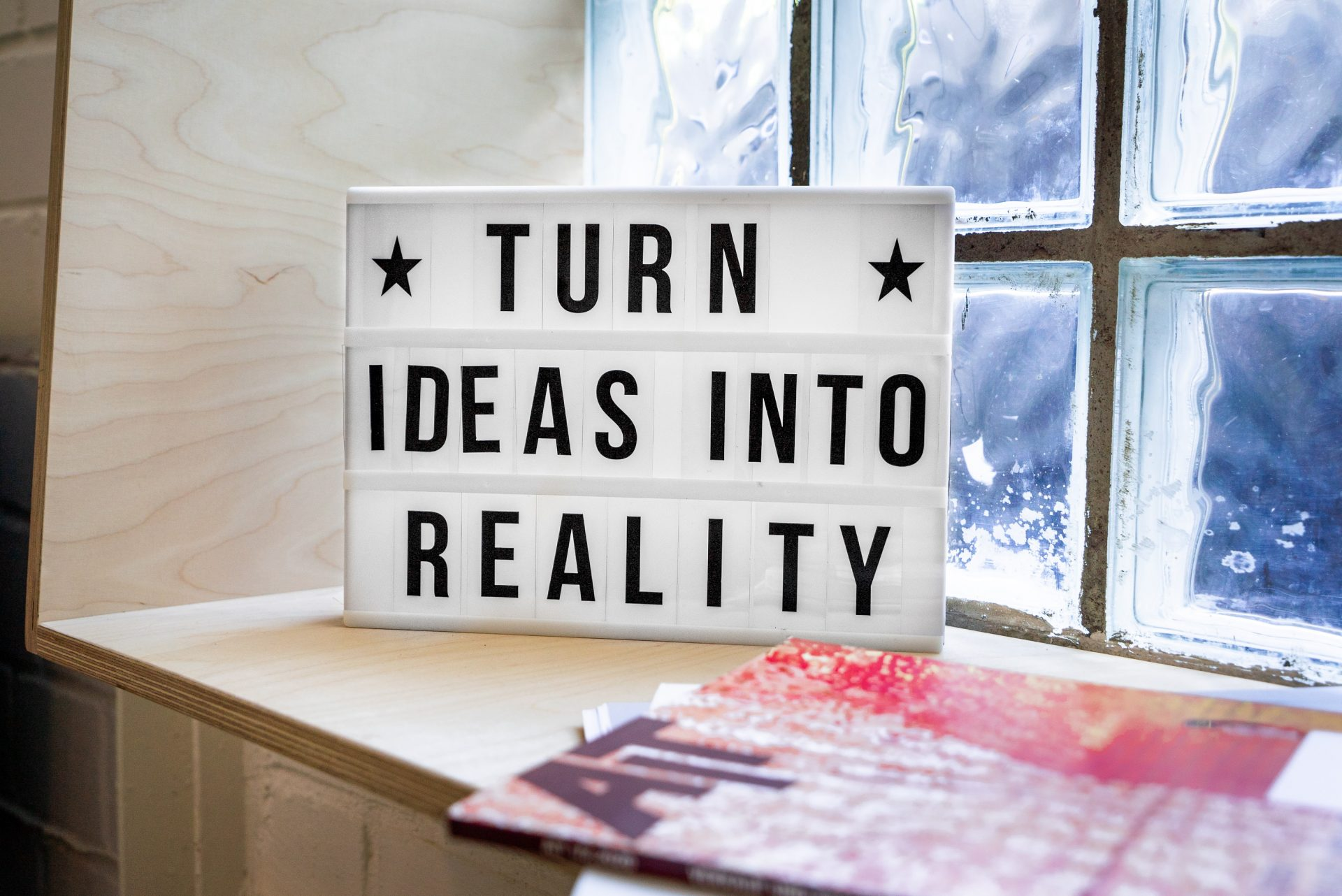 turn ideas into reality motivational sign